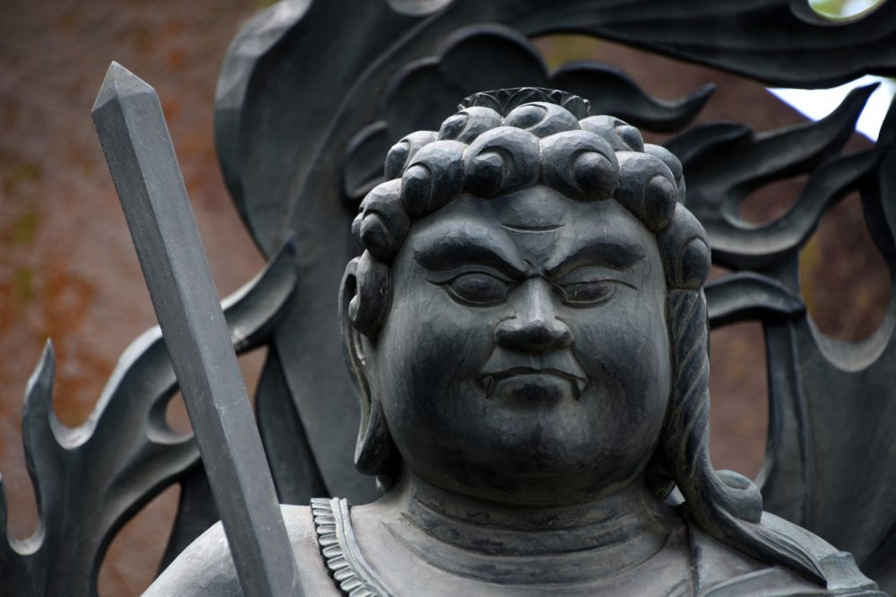 Statue of Fudo Myo-o with a strong, serious face