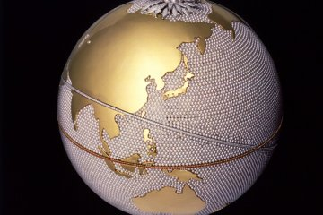 <p>A globe with land of 24 carat gold and a sea of pearls</p>