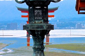 <p>A shrine lantern and torii gate at low tide</p>