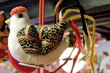 <p>This rooster was also a decoration hanging from one of the mobiles</p>