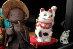 The maneki-neko or beckoning cat is makes a popular appearance.