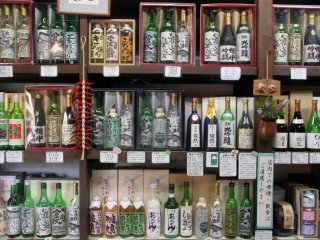 Local sake for sale—all of the bottle labels were painted by local artists