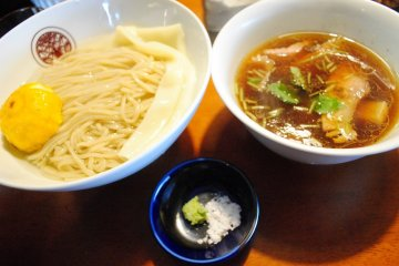 <p>Mazesoba. On the left is noodles in Kombu-sui, on the&nbsp;right is the dipping soup,&nbsp;with salt and wasabi seasoning</p>