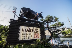 The statue of the cow atop Inanba's signboard. They really are serious about their beef.