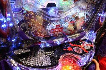<p>The pachinko balls cascade down through the metal pins and hopefully into one of the bonus areas</p>