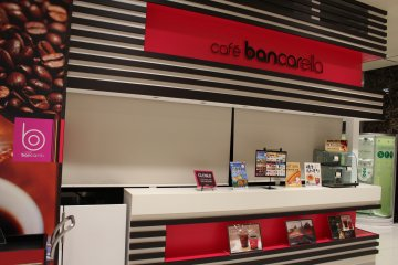 <p>A snack section offers food and drinks, but you can always order from your seat</p>