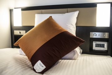 Each bed comes with feather pillows and a memory foam pillow. You can get more upon request from the reception.