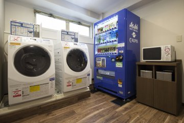 This laundry area is located on the 2nd floor. The laundry machines are coin operated.