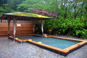 Relax while being surrounded by nature in a roten-buro (outdoor bath)