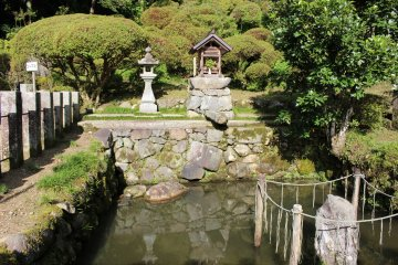 <p>The pond in which the dragon of Okadera&#39;s legend is imprisoned. The rock with the rope around it is the dragon lid. According to legend, if the rock wobbles or shakes rainy weather will follow</p>