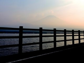 As evening fell Mount Fuji slowly appeared from the haze