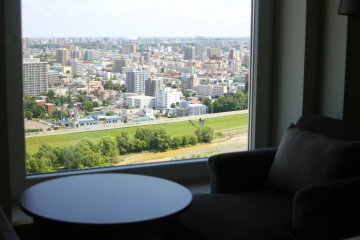 <p>Seeing the cityscape from hotel room</p>