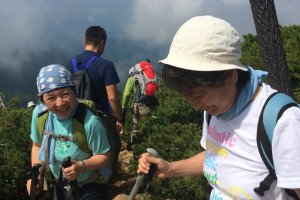 Hikers make a descent after a rest on top of Mt. Shibutsu.