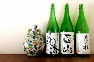 Beautiful sake bottles grace the interior of Cooking Sun.