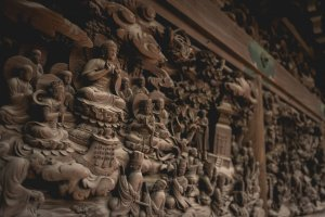 Intricately carved walls based on Lotus Sutra, inside the temple