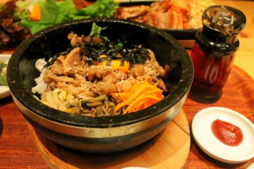 <p>The Bibimbap set complete with several kinds of side dishes including kimchi.</p>