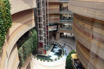 <p>The curved lines of Namba Parks glow with various hues of pink as the sun moves across the sky.</p>