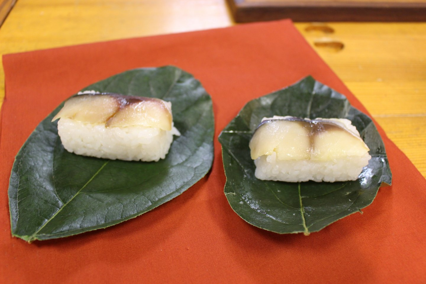 Mackerel kakinohazushi unwrapped and ready to be eaten