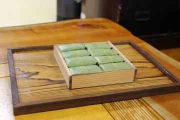<p>A box of kakinohazushi</p>