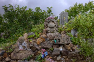 Another pebble and stone shrine with statues