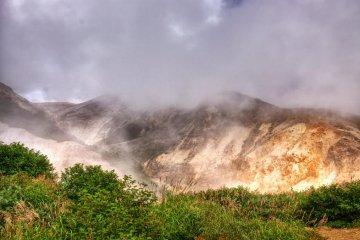 Sulphurous mountainside near Okama crater lake