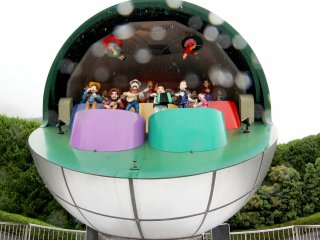 Greeting you at the entrance of the outdoor park is a bunch of automated figurines playing music in what looks like a metallic globe.