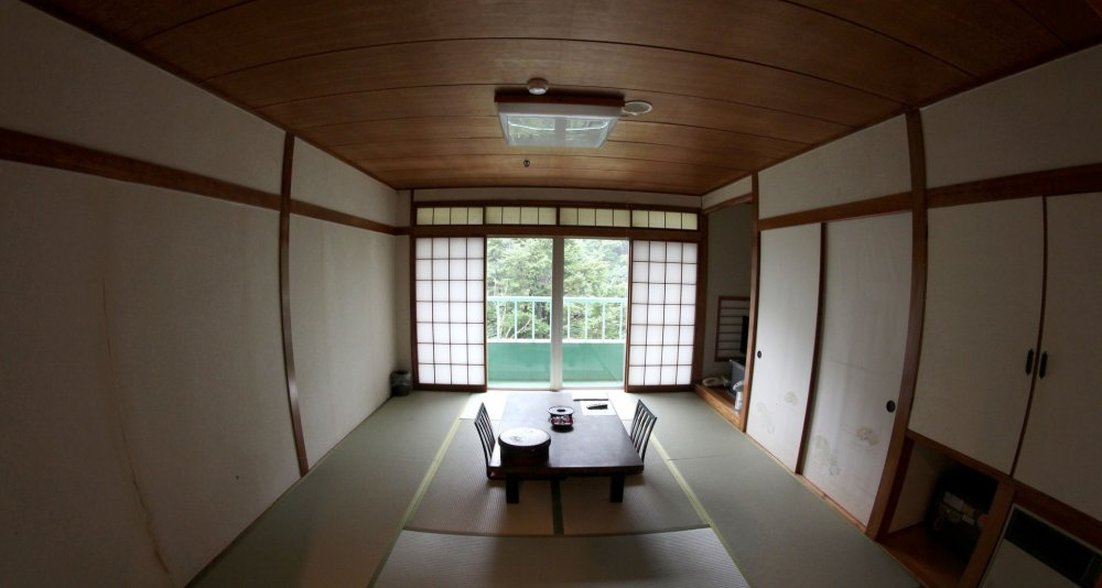 The traditionally furnished part of the room, with a tatami mat and a small table. A TV is also there of course.
