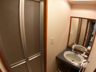 Each room has a sink and a shower area, which includes a bathtub.