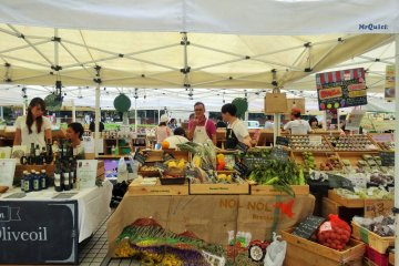 <p>Fruit and vegetable vendors at the Farmers&#39; Market in front of Aoyama&#39;s UNU</p>