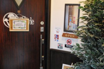 <p>The entrance of Tenjin Style, located on the 2nd floor</p>