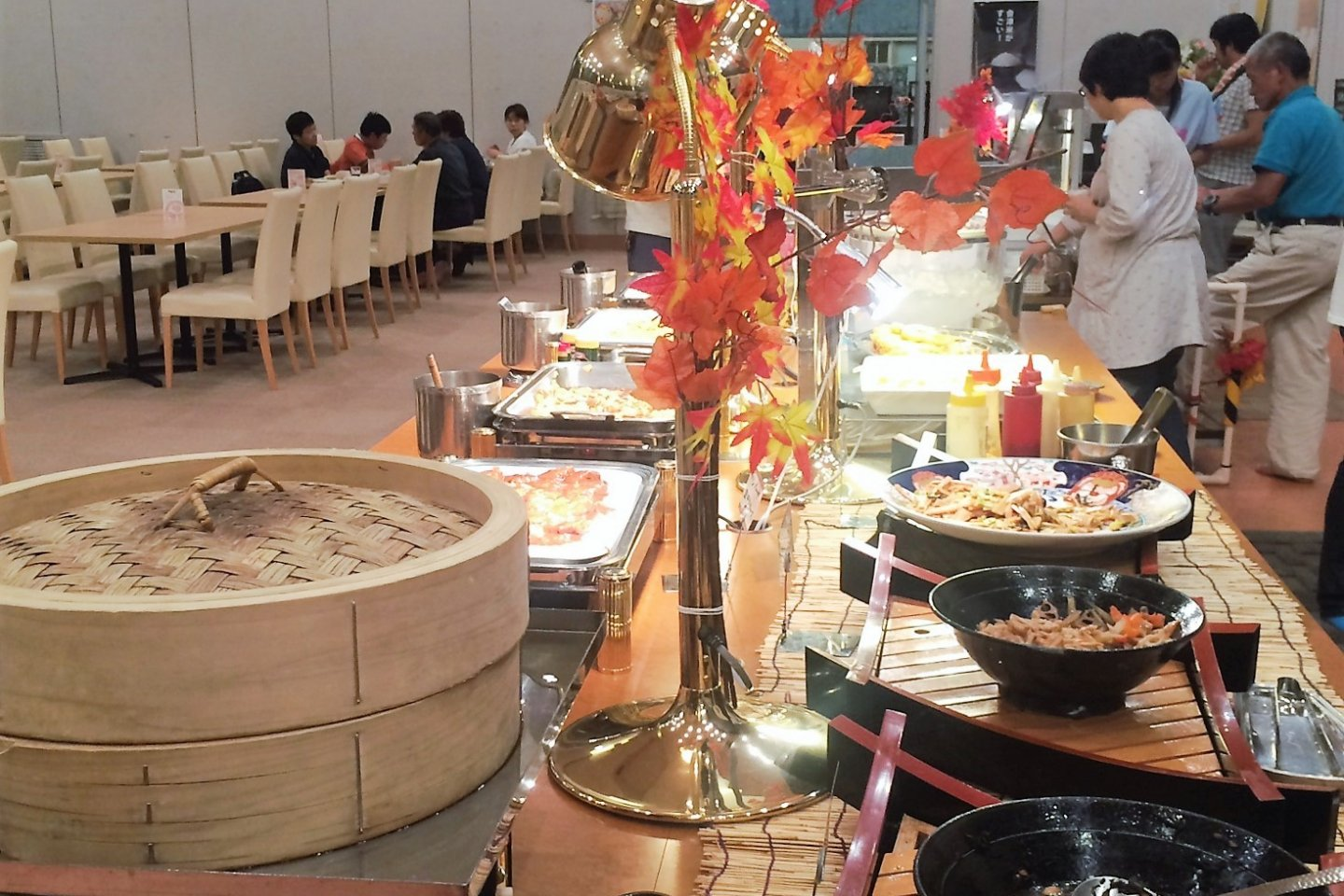 The fall display of food at one of the three tables of food.