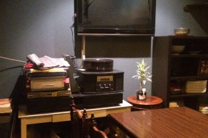 The TV and decorations in the back room.
