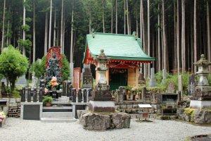 A monument and statue of Fudomyo-sama,the Buddhist deity of discipline