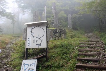<p>The junction separating the regular hiking trail and the path of worship. The right fork is the easy way, the left fork leads to the Three Tests of Courage</p>