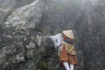 <p>The first Test of Courage, climbing the 30 foot tall Kane Kane Iwa, Hanging or Crab Rock</p>
