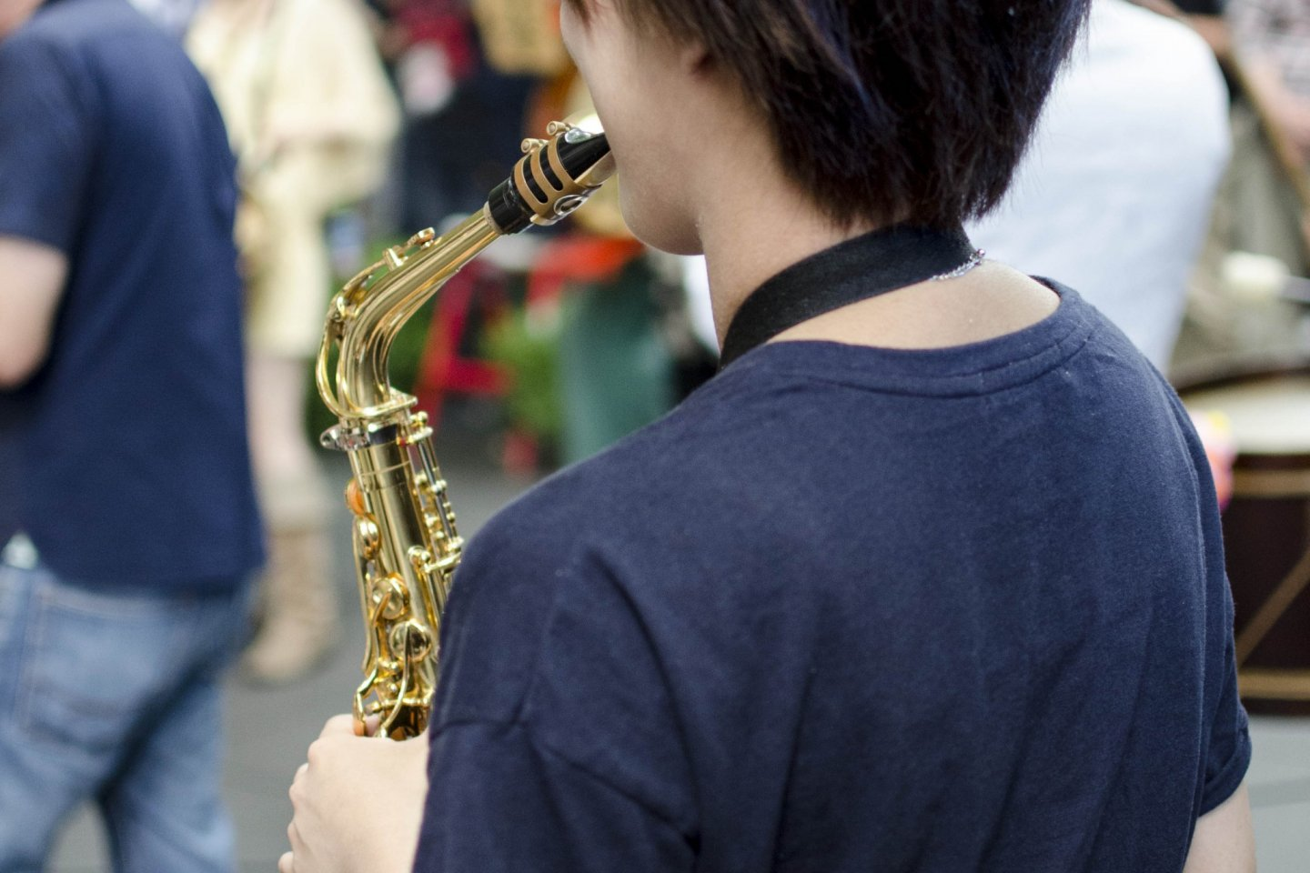 A Jazz player performing in the plaza