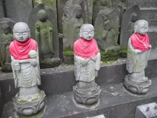 Some statues are more recent, others hundreds of years old, grown with lichen