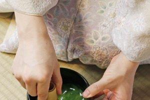 Whisking powdered green tea in Tea Ceremony Koto