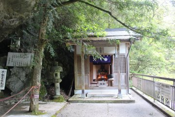 <p>The shrine and altar to the Eleven Faced King Fudomyo-sama, Buddhist deity of discipline</p>