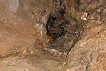 <p>The narrow passage in and out of the deepest point of the cave</p>