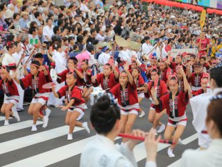 Dance of children with red Happi and Hachimaki (Headbands)