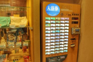 The vending machine to buy your entrance ticket and amenities