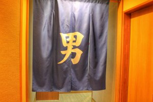 "The blue curtain reads ""otoko"" (male)"