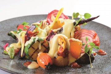Raclette cheese with grilled vegetables
