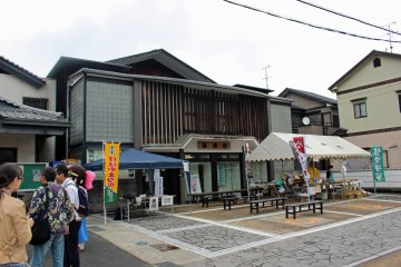 <p>The Sumo Museum and tourist information center/rest area. The white tent is a food booth selling chanko soup (a hearty soup, filled with chicken, sausage and vegetables, eaten by sumo wrestlers to achieve their large size). It also had yaki-dango, konyaku and locally made omiyage</p>