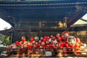 Dolls piled up in front of the main prayer hall waiting to be burnt during a  Buddhist ceremony