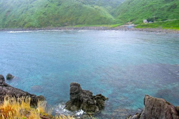 Kamaya Beach and campground and the blue water of the cove