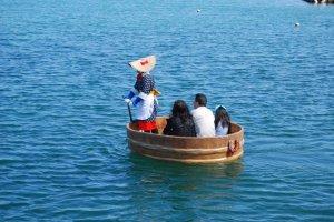 A family taking a tarai bune trip in Ogi Harbor