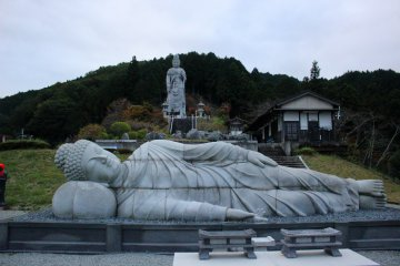 <p>The reclining Buddha and the standing Buddha above it. They were built to this scale and given this placement so that, when viewed (in person) from this angle they appear to be the same size.</p>