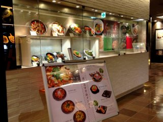 The restaurant's exterior showcases sample Korean dishes